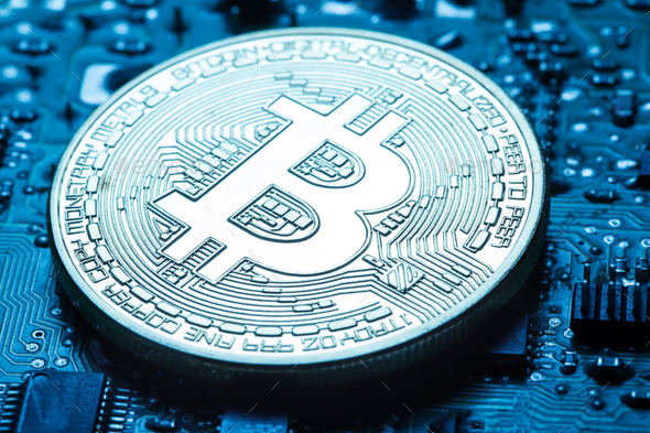 Virtual currency is the golden bitcoin on background of printed - Stock Photo - Images