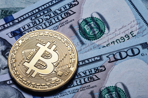 Gold bitcoin on hundred dollar bills - Stock Photo - Images