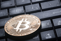 Crypto currency gold bitcoin on the computer keyboard - PhotoDune Item for Sale