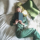 Young blonde female in silky pyjamas with book in bed  - PhotoDune Item for Sale