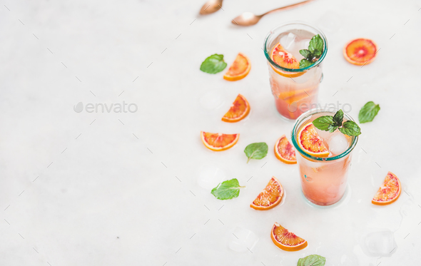 Blood orange fresh summer lemonade in glasses, copy space - Stock Photo - Images