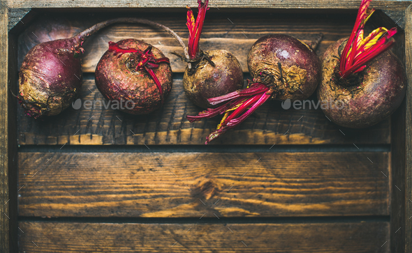 Raw organic purple beetroots in rustic wooden box, copy space - Stock Photo - Images