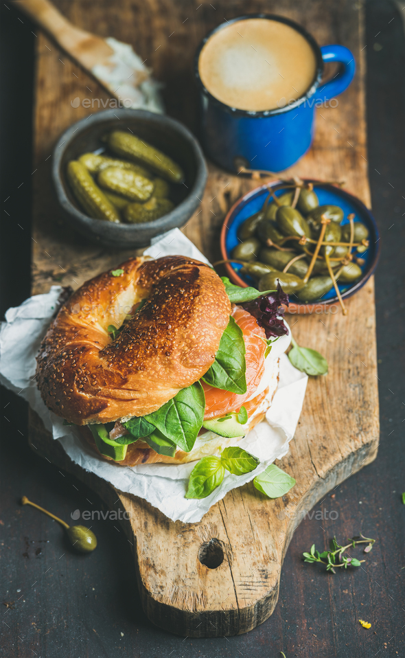 Breakfast with salmon, avocado, cream-cheese, basil bagel, espresso coffee, capers - Stock Photo - Images