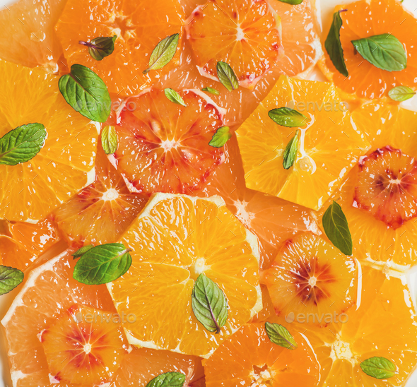 Fresh citrus fruit salad with mint and honey, close-up - Stock Photo - Images