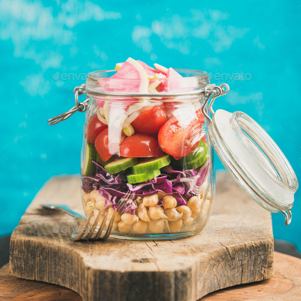 Vegetable and chickpea sprout vegan salad in jar, square crop - Stock Photo - Images