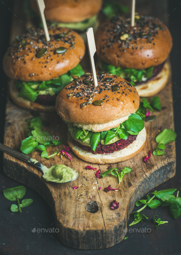Healthy homemade vegan burger with beetroot-quinoa patty and avocado sauce - Stock Photo - Images