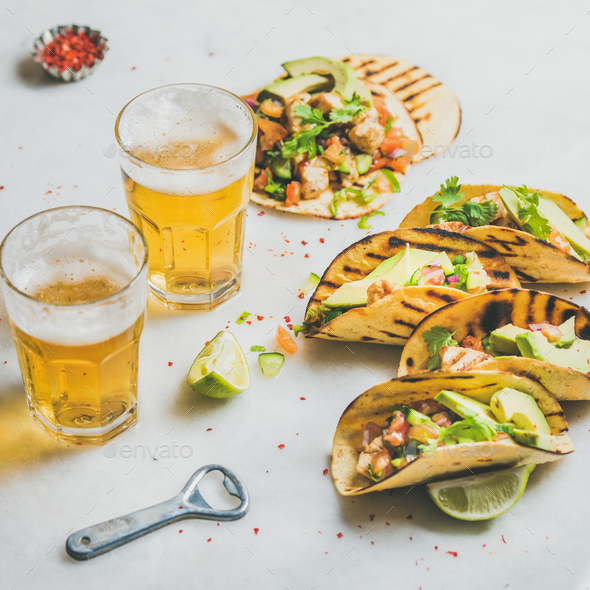Healthy corn tortillas with beer in glasses over light background - Stock Photo - Images