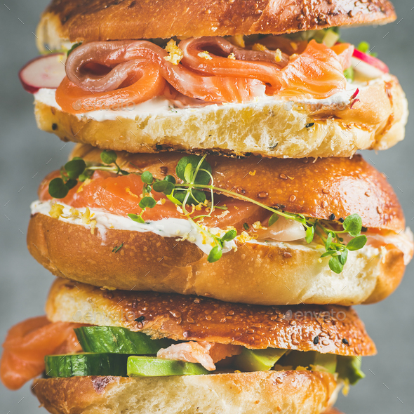Close-up of Bagels with salmon, eggs, vegetables, capers, cream-cheese, herbs - Stock Photo - Images