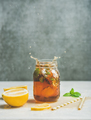 Summer Iced tea with lemon and herbs, copy space