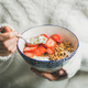 Healthy breakfast yogurt, granola, strawberry bowl in woman's hands - PhotoDune Item for Sale