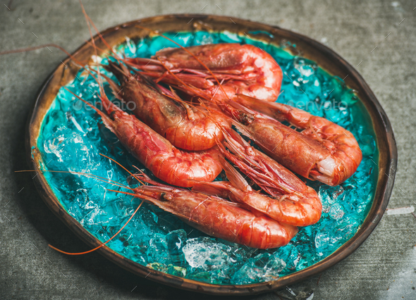 Raw uncooked red shrimps on chipped ice, selective focus - Stock Photo - Images
