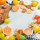 Citrus fruits slices on wooden board over grey marble background - PhotoDune Item for Sale