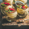 Homemade dessert Tiramisu in glasses with fresh raspberries on board