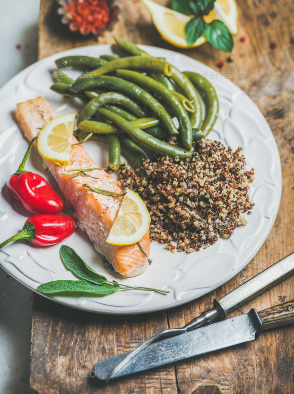 Roasted salmon with multicolored quinoa, chilli pepper and poached beans - Stock Photo - Images