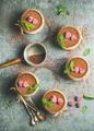 Homemade Tiramisu in individual glasses with raspberries, copy space