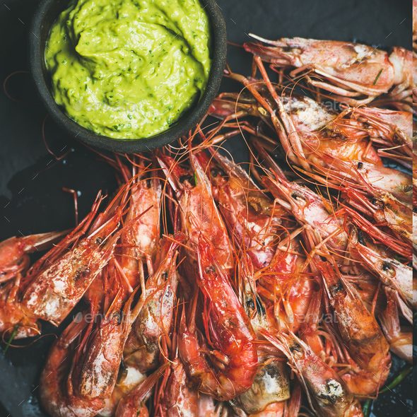 Roasted red shrimps with guacamole avocado sauce, square crop - Stock Photo - Images