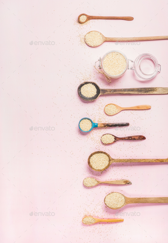 Quinoa seeds in different spoons and jar over pink background - Stock Photo - Images