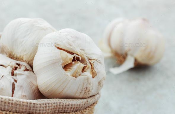 Garlic on concrete floor - Stock Photo - Images