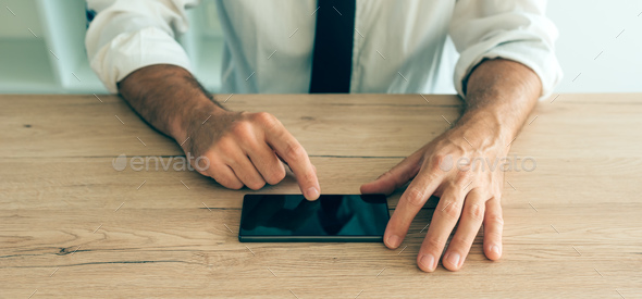 Smartphone in hands of successful businessman - Stock Photo - Images