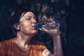 Woman drinking water outdoors - PhotoDune Item for Sale