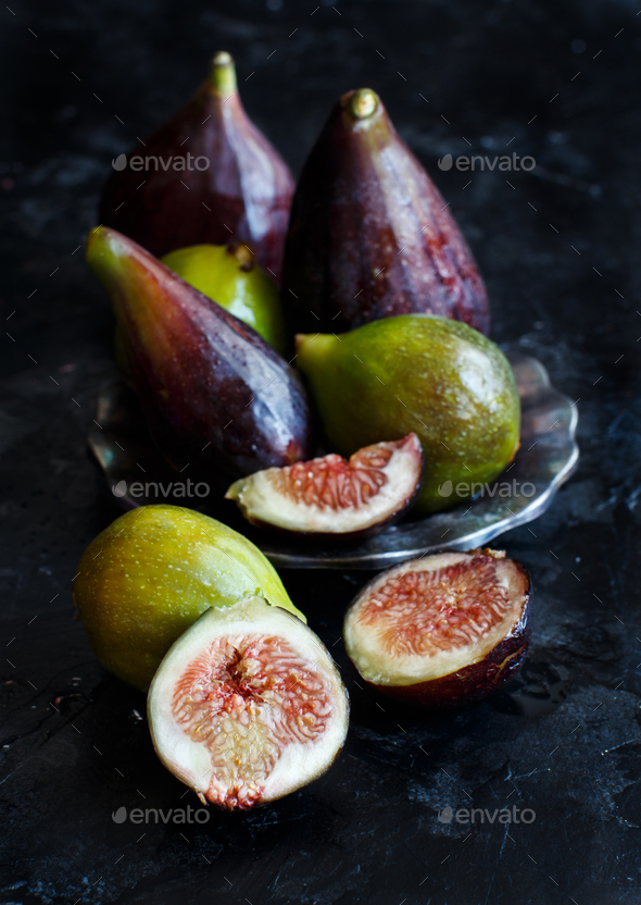 Green and purple figs  on a dark  background - Stock Photo - Images