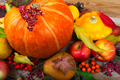 Fall background with orange pumpkin, yellow squash, pear