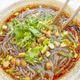 Spicy noodle soup with vegetables, herbs, peanuts and coriander. - PhotoDune Item for Sale