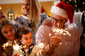 happiness, Christmas, family concept-family with sprinklers Chri
