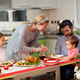 Mother serving turkey to his family in Christmas dinner - PhotoDune Item for Sale