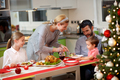 Mother serving turkey to his family in Christmas dinner