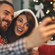 Couple making selfie for Christmas - PhotoDune Item for Sale