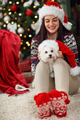 girl holding a Christmas present puppy dog - PhotoDune Item for Sale