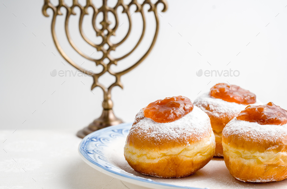 Hanukkah Minor, donuts with jam on a plate on a white background - Stock Photo - Images
