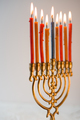 Brass hanukiya with lighted candles side view - PhotoDune Item for Sale
