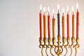 Brass hanukiya with lighted candles close-up - PhotoDune Item for Sale