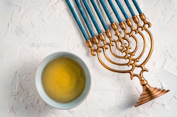 Fragment of Hanukkah with blue candles and butter in a bowl top view - Stock Photo - Images