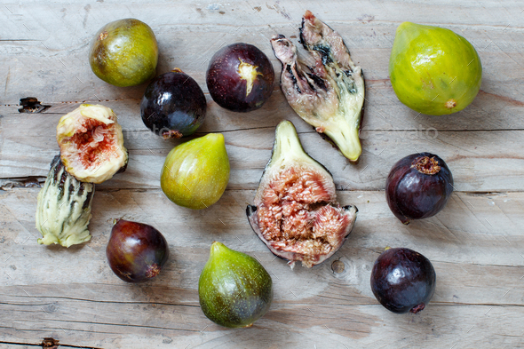 Green and purple figs  on wooden rustic background - Stock Photo - Images