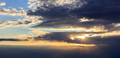 Astonishing view of sunset with dark clouds and golden sunbeams. - PhotoDune Item for Sale