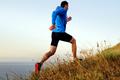dynamic running uphill male athlete