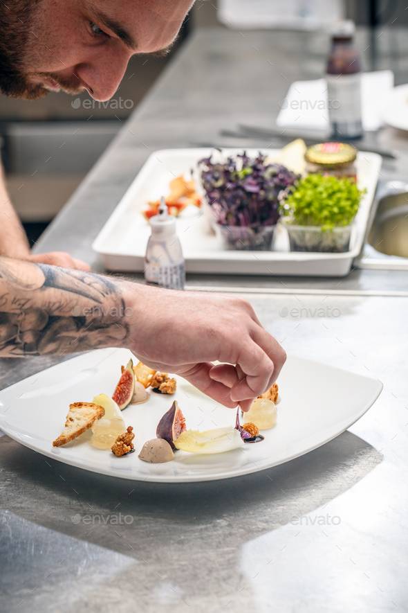 A chef preparing appetizer - Stock Photo - Images