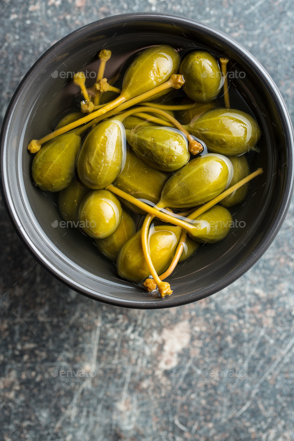 Pickled caper berries. - Stock Photo - Images