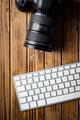 Professional digital camera and computer keyboard.