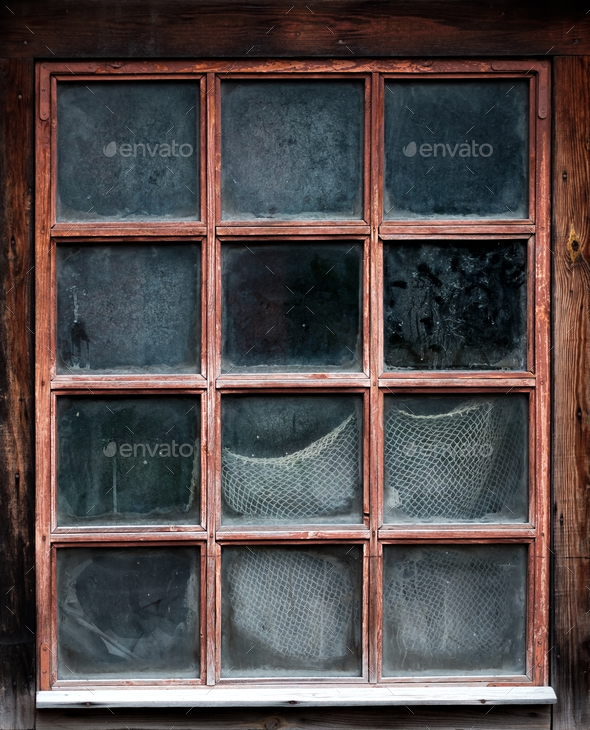 The window of an old,wooden farm house with net - Stock Photo - Images