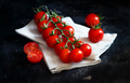 Cherry tomatoes on a dark background