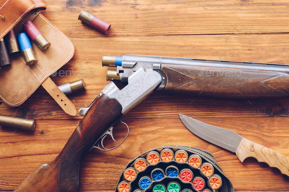 Hunting equipment. Shotgun, hunting cartridges and hunting knife - Stock Photo - Images