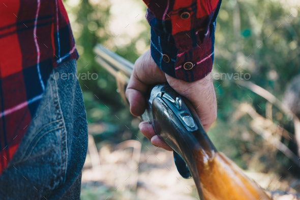 Hunter with a gun  on the forest - Stock Photo - Images