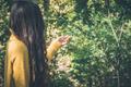 Young girl with long hair, enjoying nature