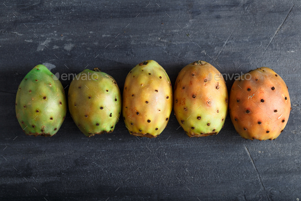 Colorful opuntia or prickly pear fruit on stone background - Stock Photo - Images