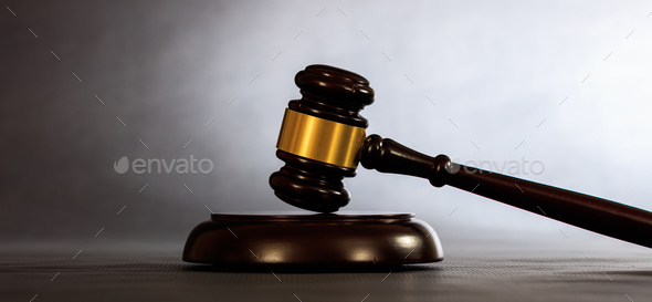 Judge or auction gavel on a dark background - Stock Photo - Images
