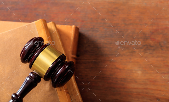 Judge gavel on law books, wooden desk, top view - Stock Photo - Images